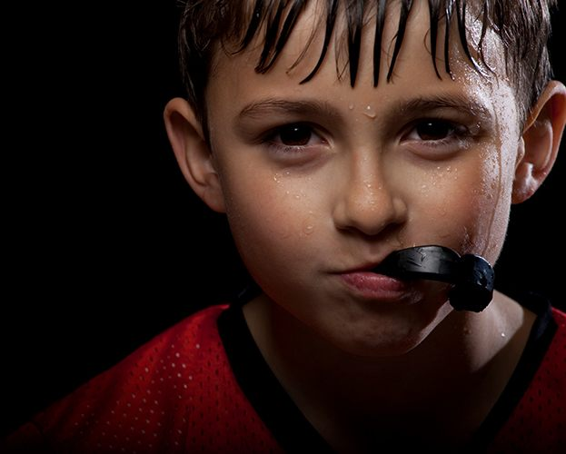Preteen boy with athletic mouthguard