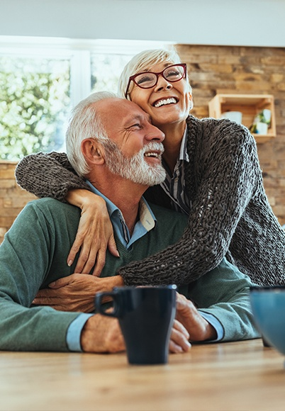 Smiling older man and woman drinking coffee