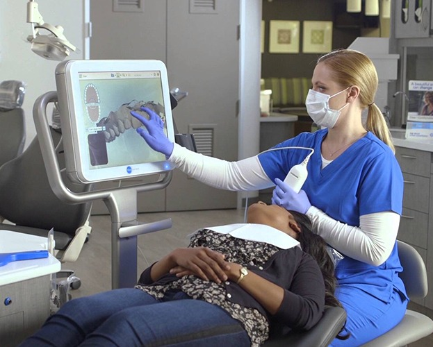 Dentist and patient looking at iTero intraoral images