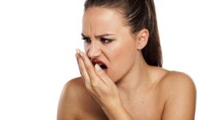 woman checking breath