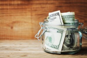 jar of money to maximize dental insurance benefits